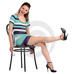 Girl Take Leg Up Sitting On Stool. Royalty Free Stock Photos - Image: 18313588
