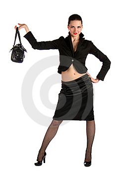 Girl In Black Suit Demonstrate Bag. Royalty Free Stock Photo - Image: 18315235