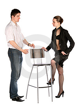 Girl In Black And Man In White At The Stool. Stock Images - Image: 18315574