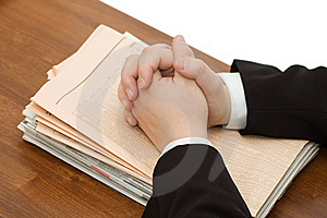 Hands Of The Businessman On A Pile Of Newspapers Stock Images - Image: 18326004