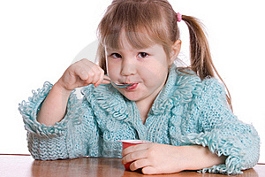 The Little Girl Eats Yoghurt Stock Photos - Image: 18326083