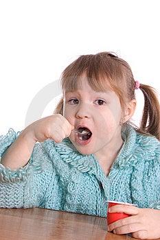The Little Girl Eats Yoghurt Royalty Free Stock Photo - Image: 18326085