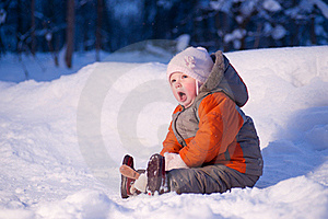 Cute Adorable Baby Sit On Snow In Park Stock Photography - Image: 18334022