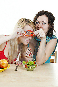 Girlfriends Cheerfully Play With Food Royalty Free Stock Photos - Image: 18358588