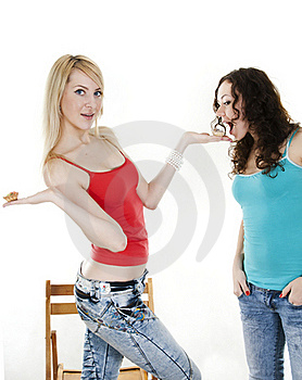 Harmonious Girl Treats The Friend With Cakes Royalty Free Stock Photo - Image: 18358965