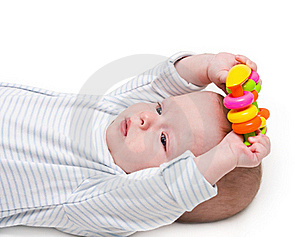 The Kid, Holds A Toy Two Hands Stock Photo - Image: 18375060