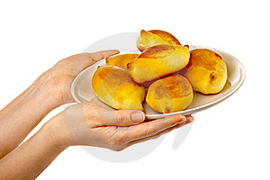 Woman's Hands Holding A Tasty Pies On A Plate. Royalty Free Stock Photography - Image: 18381737