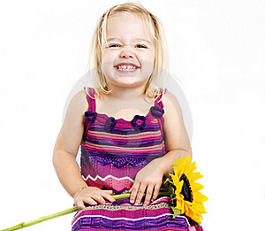Young Girl Smiling With Sunflower Stock Photography - Image: 18388892