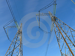 Power Lines Against The  Blue Sky Royalty Free Stock Photo - Image: 18390055