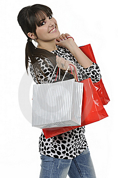 Young Woman Holding Shopping Bags Royalty Free Stock Image - Image: 18390976
