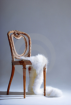 Old-fashioned Wooden Chair With White Fur Royalty Free Stock Photos - Image: 18394528