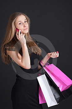 Girl With Shopping On The Phone Stock Photography - Image: 18401382