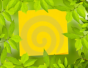 Yellow Post It Not With Green Leave Royalty Free Stock Photography - Image: 18402617