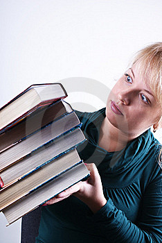 Girl Holds The Pile Of Books Stock Photos - Image: 18407203
