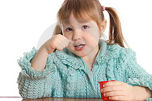 The Little Girl Eats Yoghurt Stock Photo - Image: 18421790