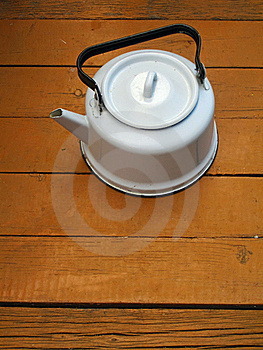 Old Kettle On The Wooden Floor Royalty Free Stock Images - Image: 18423849