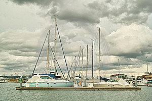 Boats In Moorage Against Clouds Stock Images - Image: 18427104