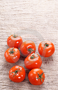 Tomato On A Old Fabric Royalty Free Stock Photos - Image: 18428688