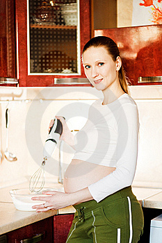 Pregnant Woman In Kitchen Making A Food Royalty Free Stock Photo - Image: 18435355
