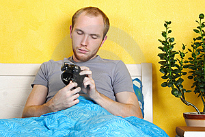 Man Lying In Bed And Winding Up Alarm Clock Stock Images - Image: 18442564
