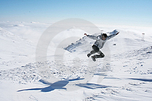 Young Man Jumping In The Snow For Fun Stock Images - Image: 18456624