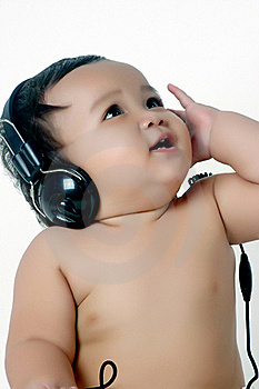 A Chubby Little Girl Listen To Music With Headphon Royalty Free Stock Image - Image: 18472326
