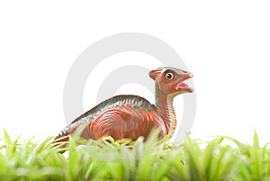 Toy Dinosaur In Grass Stock Image - Image: 18482121
