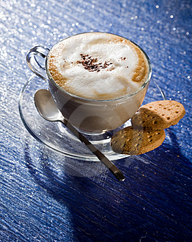Cappuccino On Blue Glass Table Royalty Free Stock Image - Image: 18488086