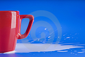 Part Of Red Big Cup With Milk Stock Image - Image: 18488781