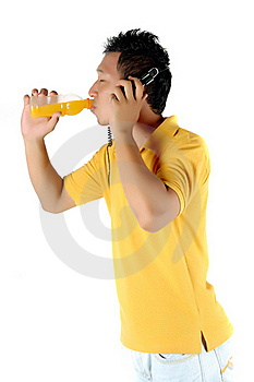 A Young Man Was Drinking A Bottle Of Orange Juice Royalty Free Stock Photo - Image: 18508875