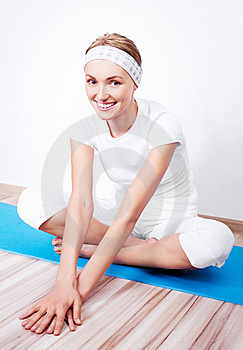 Woman Stretching The Muscles Stock Photo - Image: 18515200