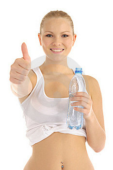 Contented Woman Holding A Water Bottle Royalty Free Stock Image - Image: 18519796