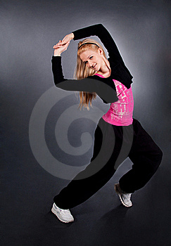 Modern Style Dancer Posing Over Grey Royalty Free Stock Photography - Image: 18520517