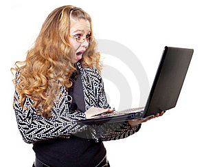 Surprised Young Woman With Laptop Stock Photos - Image: 18534463