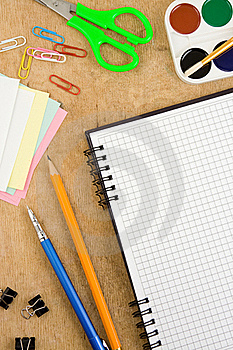 School Accessories And Checked Notebook On Wood Royalty Free Stock Photos - Image: 18581528