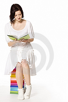 Girl On Book Stack Reading. Royalty Free Stock Photography - Image: 18596117