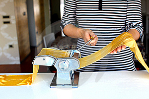 Making Pasta Dough On The Machine At Home Royalty Free Stock Image - Image: 18596476