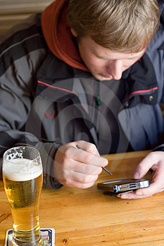 Man With Beer And Palm-size Computer Royalty Free Stock Photos - Image: 1865918