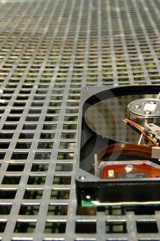 Hard Disk On A Metal Grid Royalty Free Stock Photography - Image: 1868267