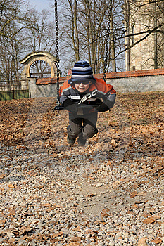 Child On Swing Royalty Free Stock Photography - Image: 18601537