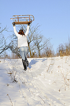 Woman Carrying Sledge Royalty Free Stock Photography - Image: 18613537