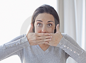 Young Woman Covering Her Mouth With Both Hands Royalty Free Stock Photos - Image: 18617198