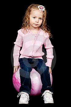 Content Girl Sitting On Her Ball Stock Photography - Image: 18630852