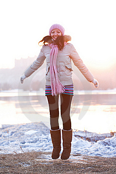 Positive Smiling Girl In Winter Clothes - Jumping Stock Image - Image: 18641781