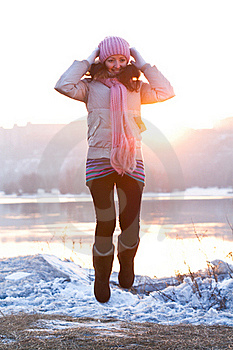 Positive Smiling Girl In Winter Clothes - Jumping Royalty Free Stock Images - Image: 18641829