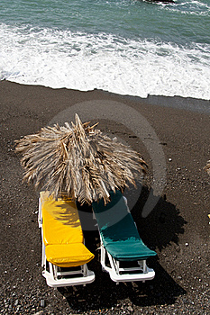 Sun Bed On A Black Beach Royalty Free Stock Images - Image: 18662599