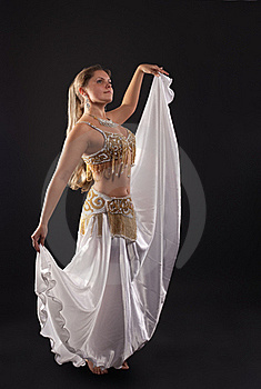 Young Woman Dance In Dark - White Arabian Costume Stock Photography - Image: 18678302
