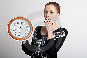 Sleeping Girl With A Big Clock In His Hands Royalty Free Stock Photo - Image: 18688035