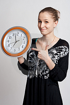 Beautiful Girl With A Big Clock In His Hands Royalty Free Stock Photos - Image: 18688058