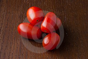 Group Of Red Cherry Tomatoes On Wood Table Royalty Free Stock Image - Image: 18697416
